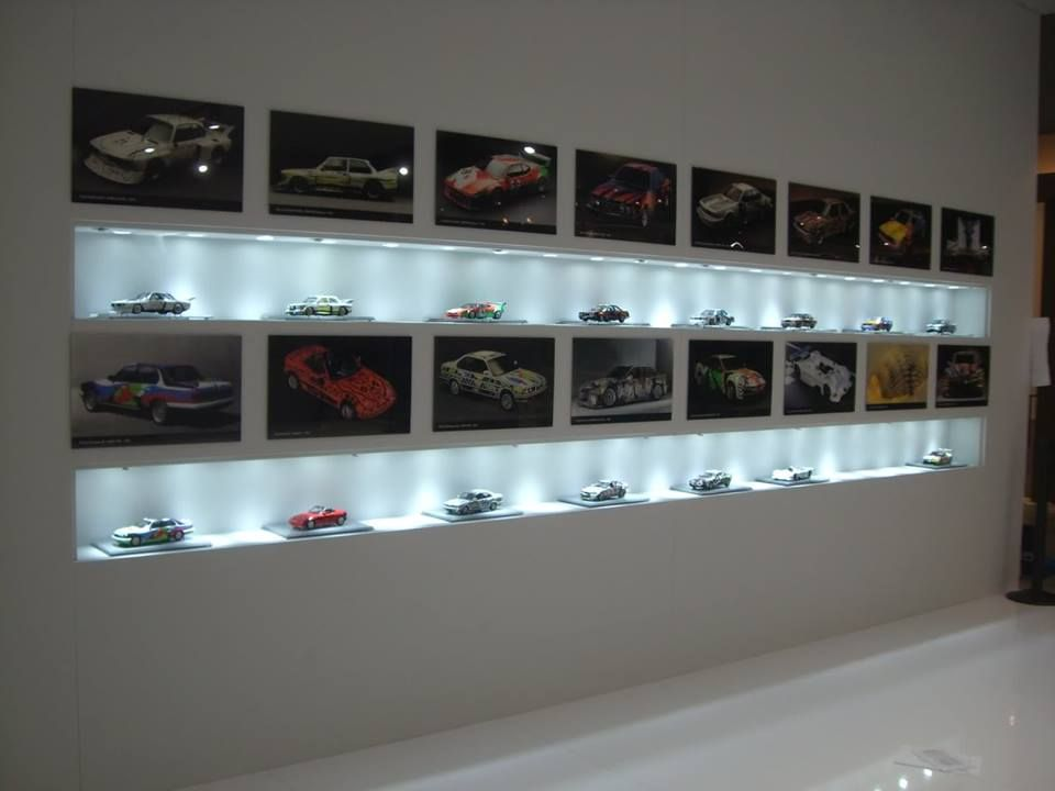 Diecast models displayed with pictures of the actual car. Cool ...