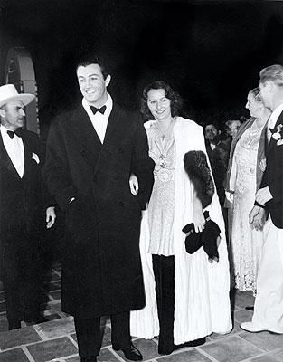 Robert Taylor and Barbara Stanwyck arrive at the Plaza Theatre for the world premiere of Camille.