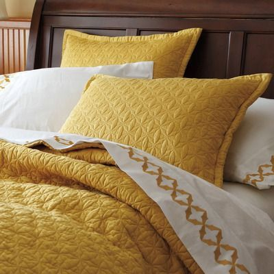 Mustard Quilt Throw And A Couple Of Shams For Your Bed