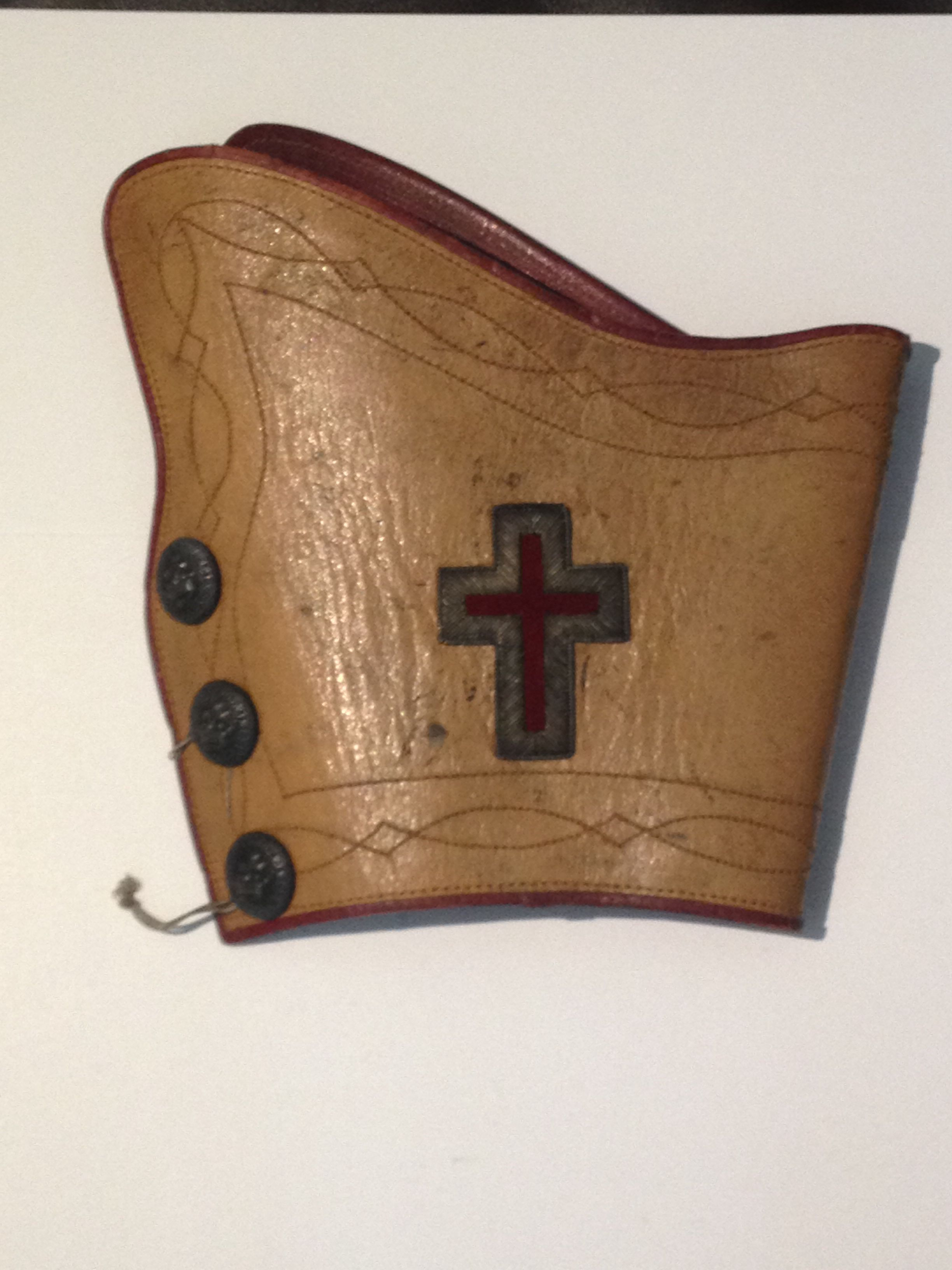 a leather knights templar cuff from the early 1800s originally white