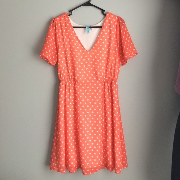 Coral Polka Dot Dress Mid thigh flowy dress. Cute and light when worn. Slight snag at the tip of the V, but unnoticeable when worn. Easily repaired. Francesca's Collections Dresses