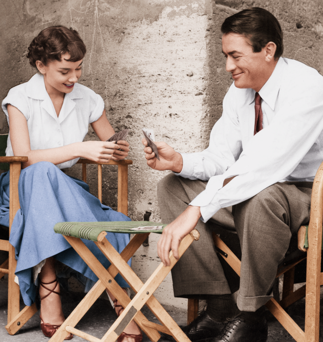 Audrey Hepburn playing cards with Gregory Peck on the set of Roman Holiday…