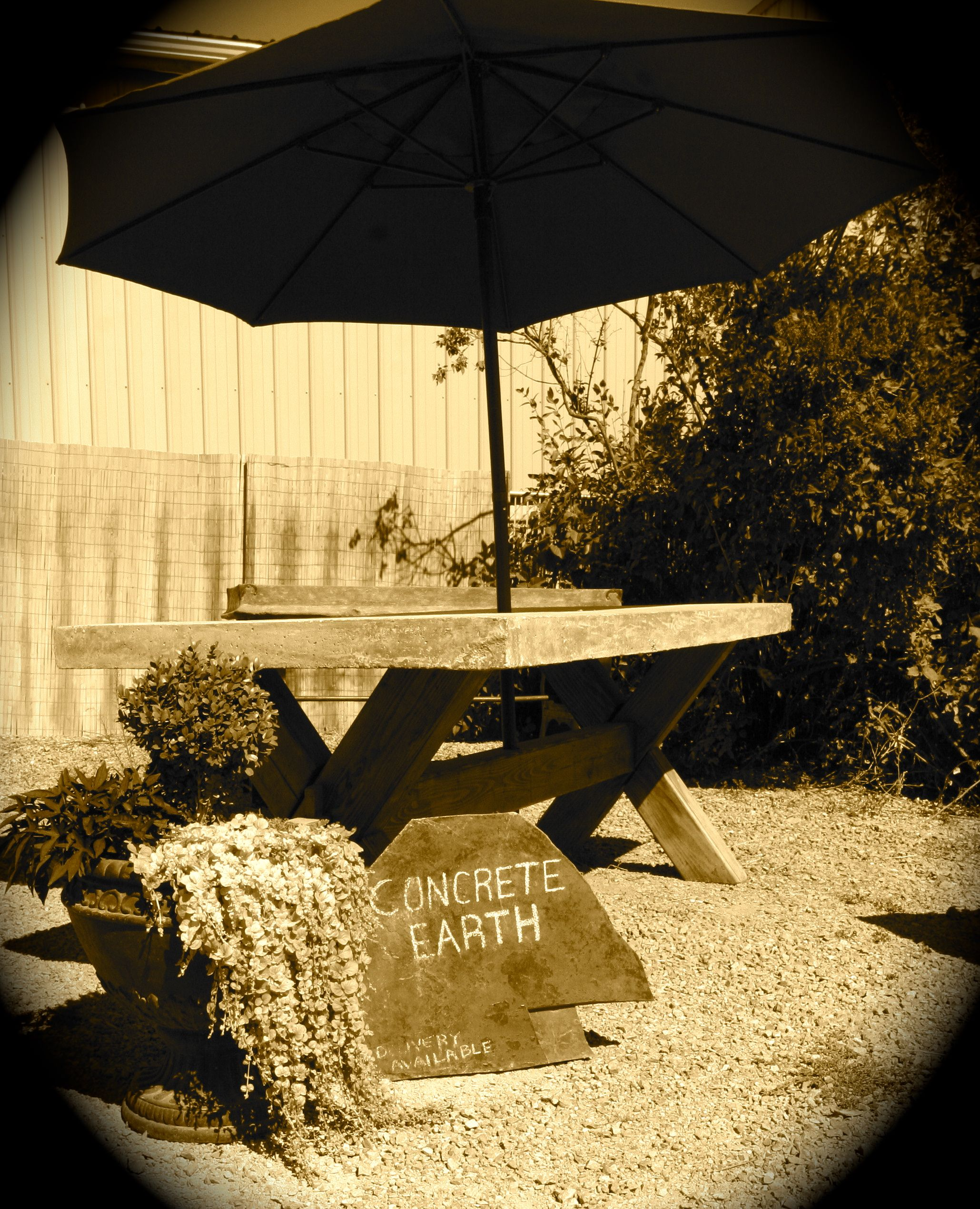 Outdoor patio table with concrete top and wooden base