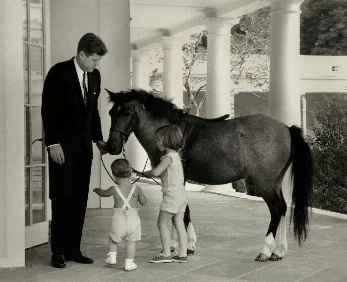 JFK with his children and their pony, Macaroni in 1962.