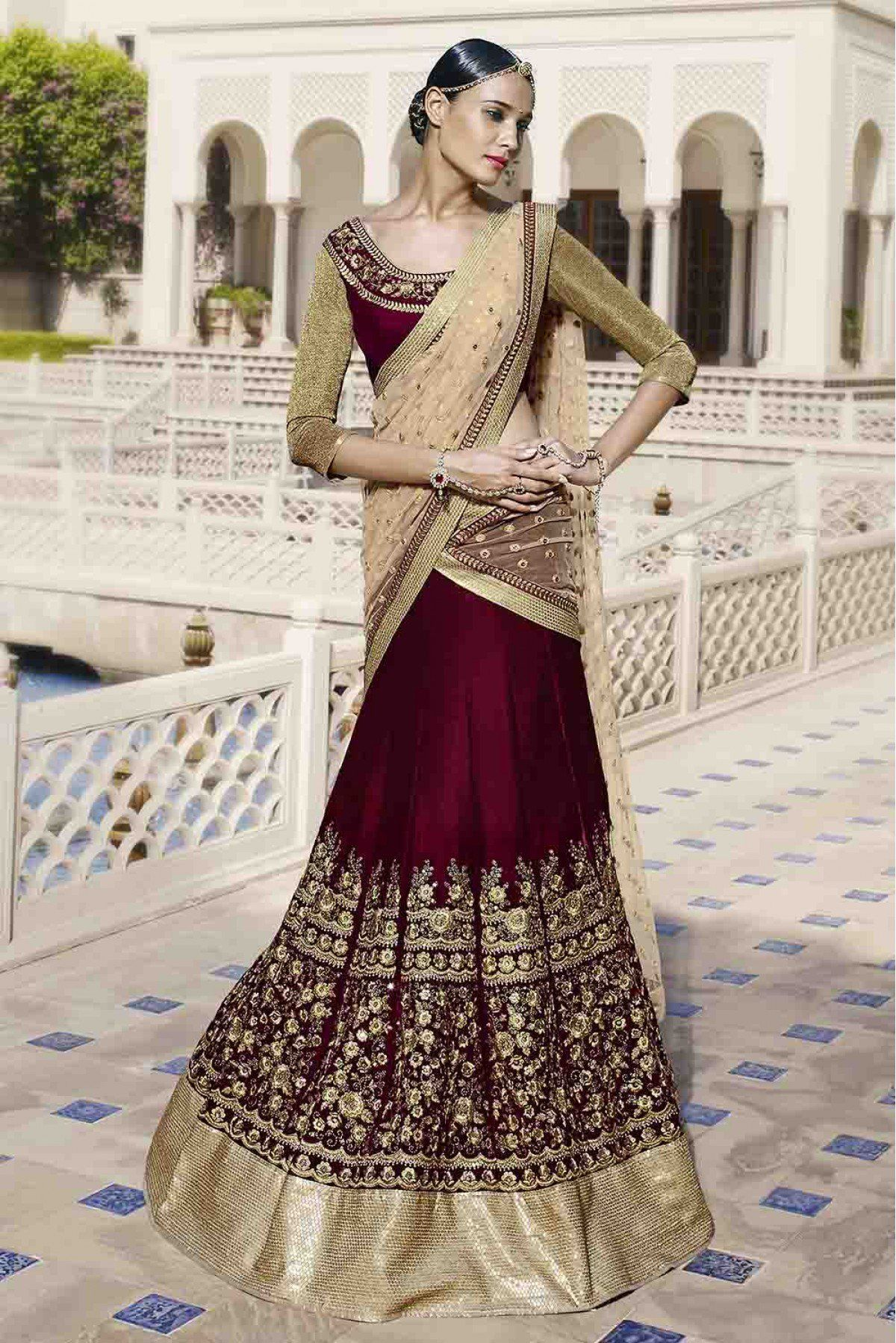faa1f903b7 Nakkashi Velvet Party Wear Lehenga Choli in Maroon Colour.It comes with  matching Dupatta and Blouse.It is crafted with Embroidery.