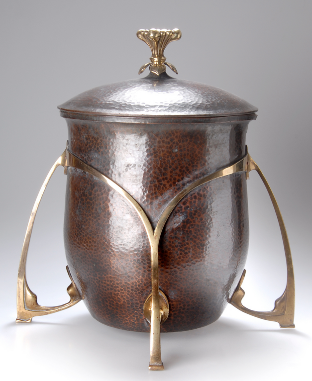 German Punch Bowl, c. 1905, hammered copper with cast brass buttressed legs, floral finial, interior tin lined, glass insert, unmarked  |  SOLD Hammer Price $635 Germany 2008