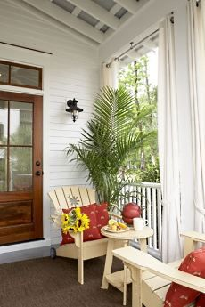 the small cottage plans featured here showcase a charming southern cottage farmhouse with white clapboard siding black shuttered windows - Cottage Plans Farmhouse Style