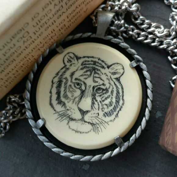 "Vintage Avon Bengal Tiger Necklace - NOS 1979 The necklace has Bengal Tiger on a cream background meant to look like ivory. The silvertone chain is 18"" and the pendant is 1 1/4"". New old stock with original packaging. avon Jewelry Necklaces"