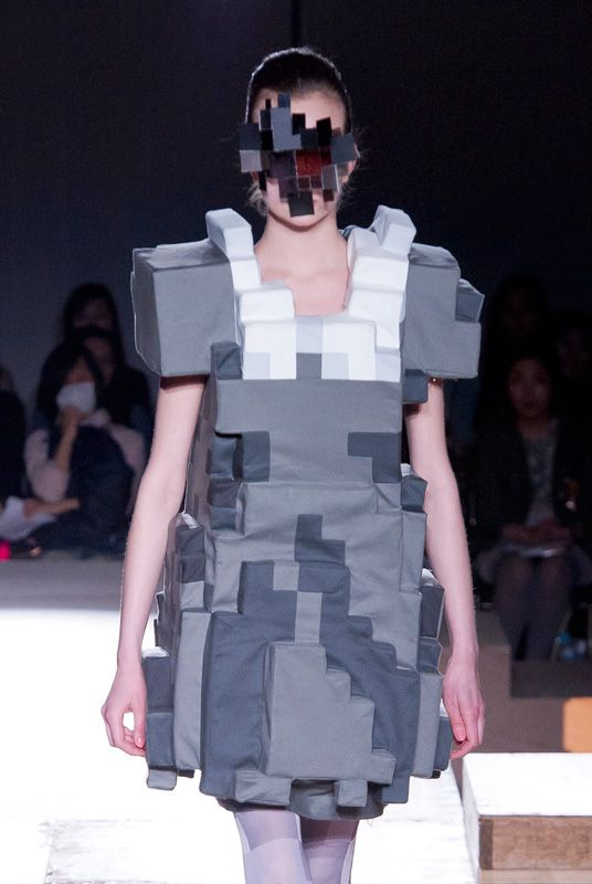 Anrealage's Fall/Winter 2011-2012 Collection designed by Kunihiko Morinaga - Japanese designer Kunihiko Morinaga showcases an 8-bit interpretation of the range of women's fashion, from dresses and professional suits to athletic styles and sweatshirts, in the pixel-patterned Fall/Winter 2011-2012 collection of his fashion company Anrealage. - http://www.anrealage.com