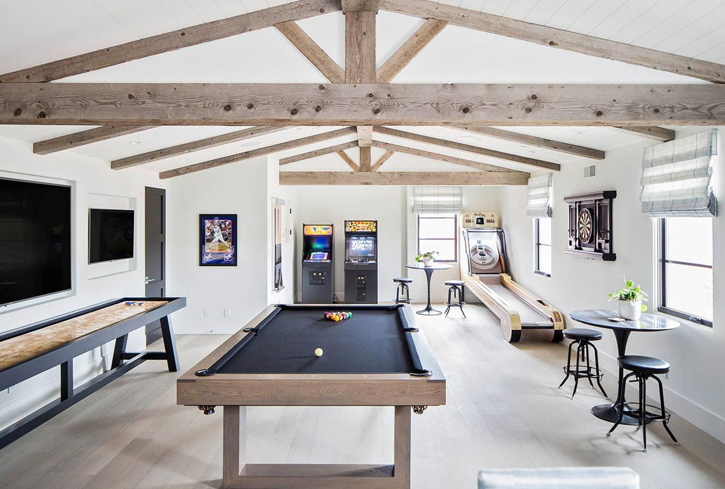 38 Best Game Room Ideas For Any Entertaining Shutterfly Game Room Idea Skee Ball Air Hockey Arca Garage Game Rooms Game Room Basement Farm House Living Room