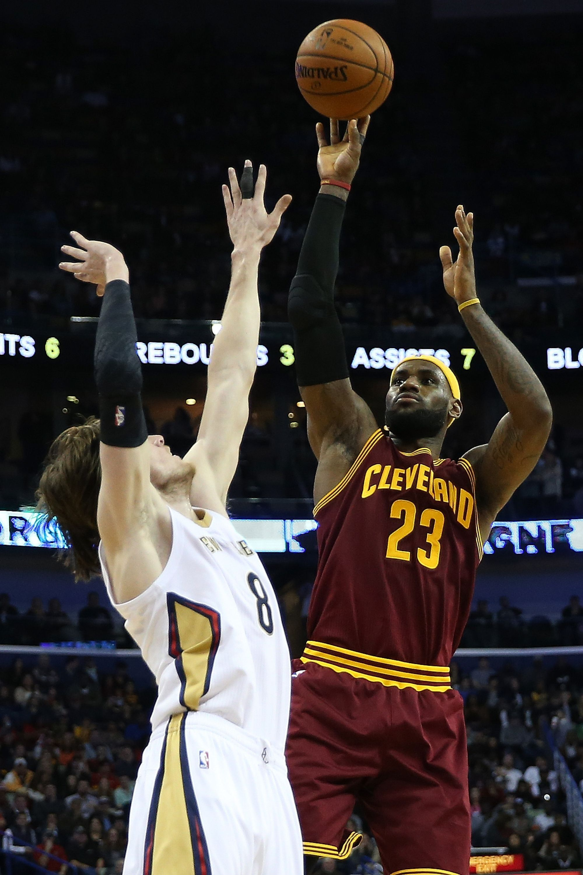 LeBron James #23 of the Cleveland Cavaliers shoots the ball over Luke Babbitt #8 of the New Orleans Pelicans at Smoothie King Center on December 12, 2014 in New Orleans, Louisiana.