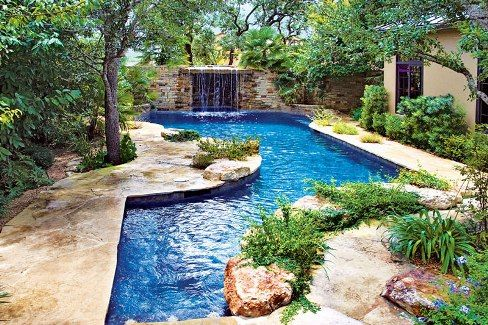 Swimming pool with natural garden patio by enclosing the pool in colorful blossoms and - Swimming pool patio designs ...