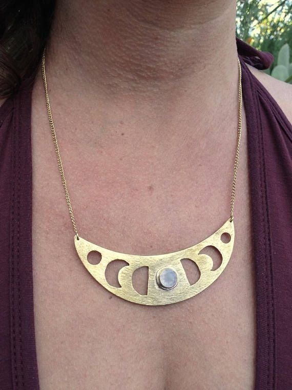 New creation! Gorgeous bib necklace, representing the phases of the moon, with the full moon in a glowing cut rainbow moonstone in the center. In high quality nickel-free brass (gold in color), with the moonstone encircled by a band of sterling silver. Also available in a smaller petite style - see photo for comparison, and link below.  Moon...