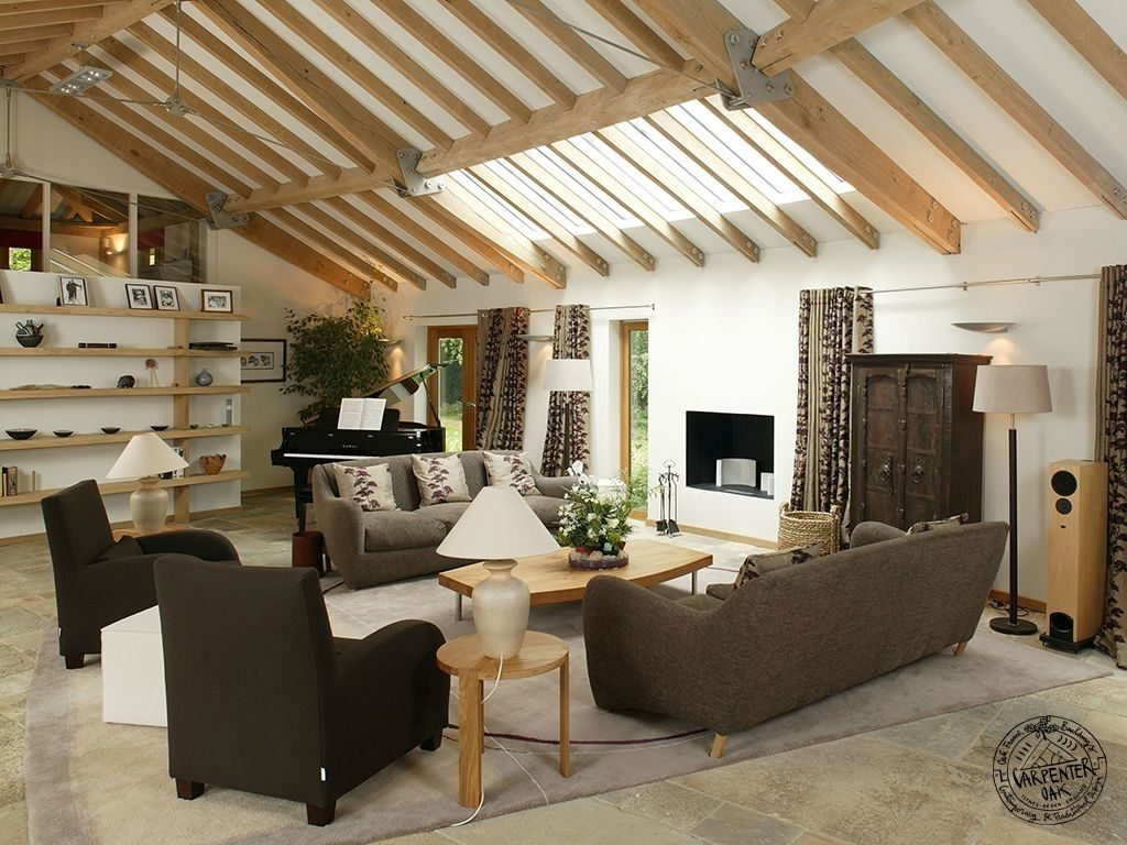 Living Room With Glazed Roof Light In Contemporary Curved Oak Framed New Build House Tower