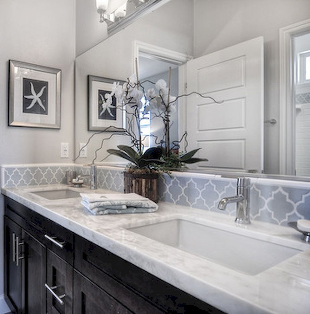 Beautiful master bath backsplash with dark cabinets