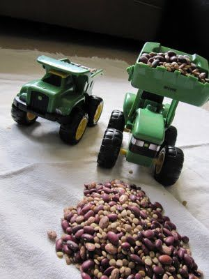 construction scene made using dried beans and toy vehicles.