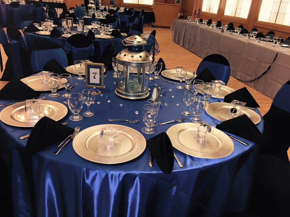 Royal Blue Table Setting With Silver Charger Plates