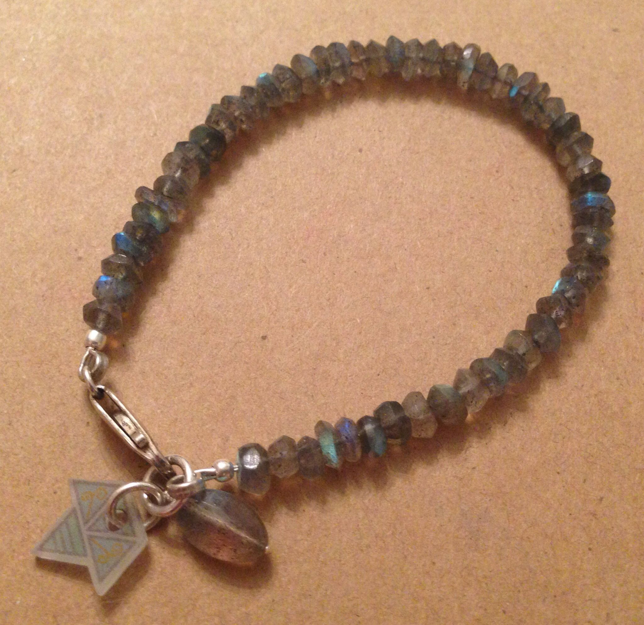 Sterling silver faceted labradorite stone bracelet, complete with Erroya charm. £42.75