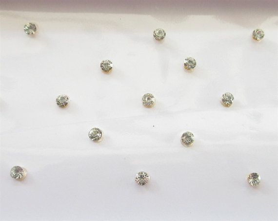 Tiny Sparkly Stick On Fake Nose Studs/Silver Fake by Beauteshoppe