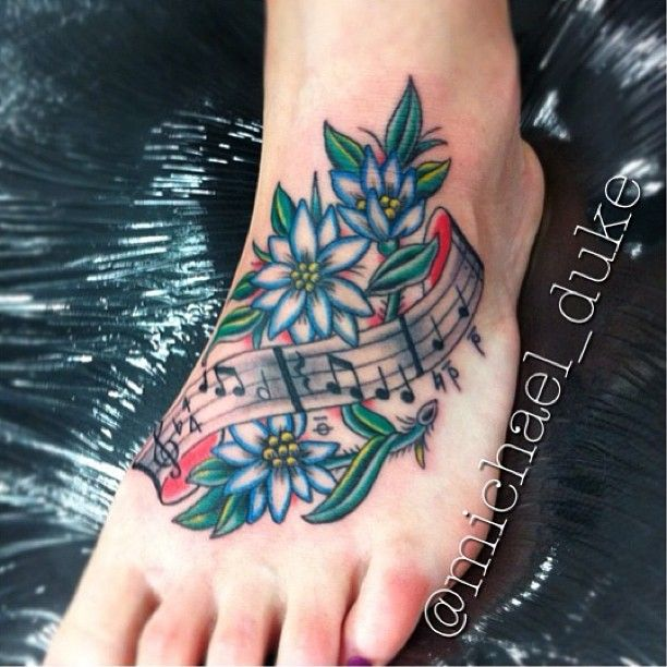 Music notes with flowers foot tattoo done by Michael Duke at Fine Tattoo Work in Orange, California
