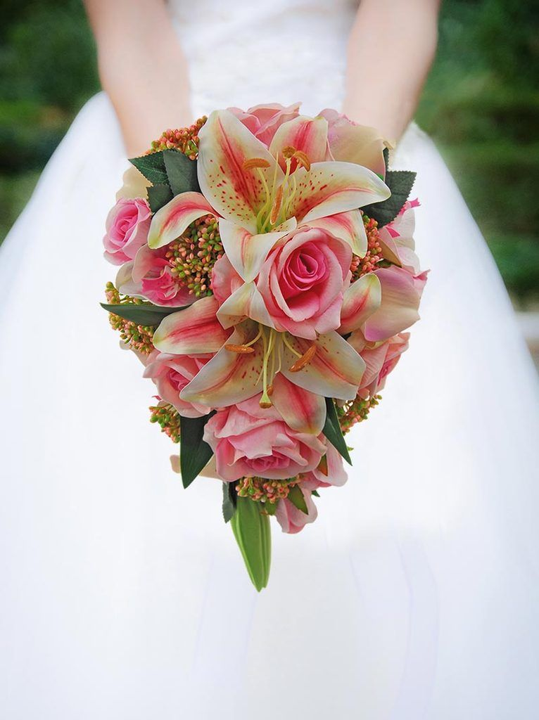 Brides tiger lily orchid pink roses calla lily wedding