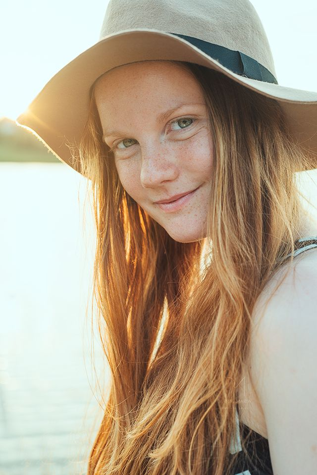 cb4090051 portrait of a freckled girl on a swedish summer evening © Rania Maria  Photography