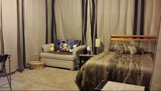 Unfinished Basement Guest Room Using Ikea Curtains Around The