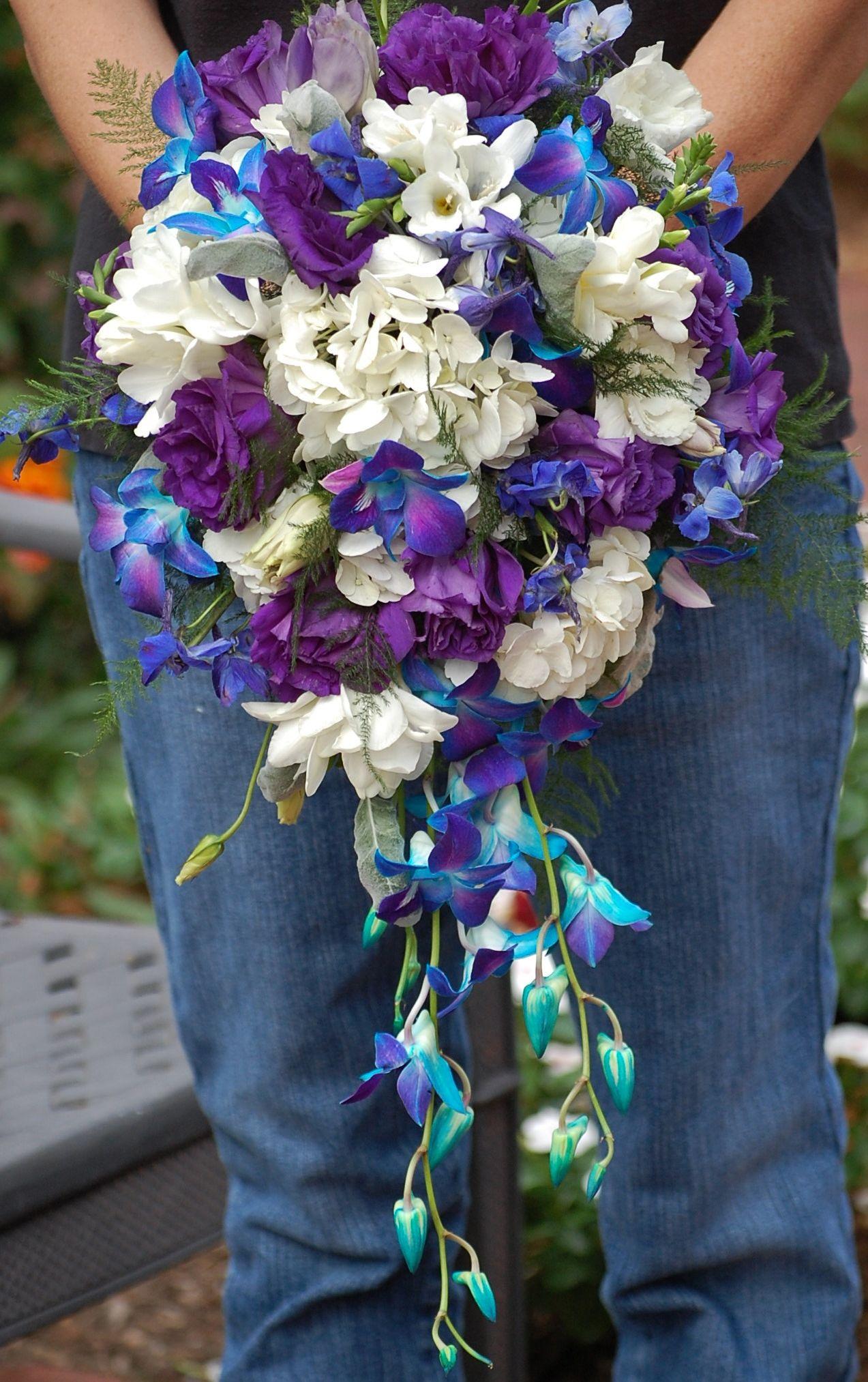 Bridal bouquet of white hydrangea white freesia dark purple