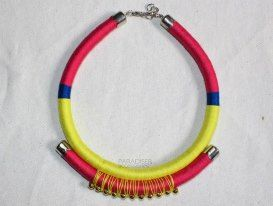 Yarn-wrapped statement necklace in summery hues!    Might be good for a little DIY?    Source: https://www.facebook.com/photo.php?fbid=423073731118160=a.423072107784989.1073741834.412984818793718=3