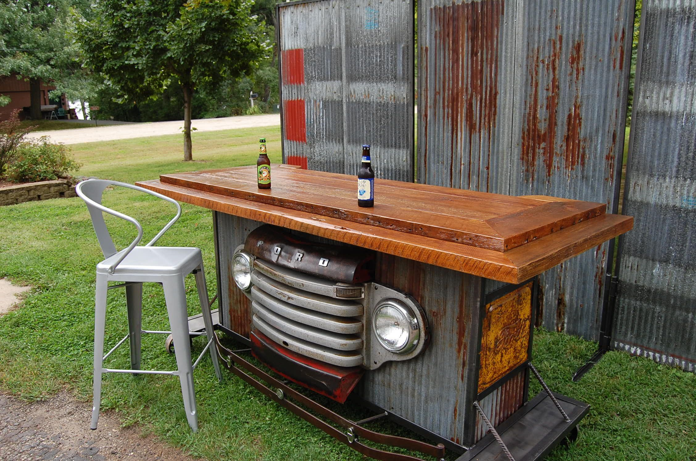 Wood bar barnwood bar barnwood furniture rustic furniture basement - Bar Made From Reclaimed Barn Wood A Vintage 49 Ford Grille Vintage Roof Tin On Cast Iron Casters Check Us Out At Sawtooth Innovations On Face Book