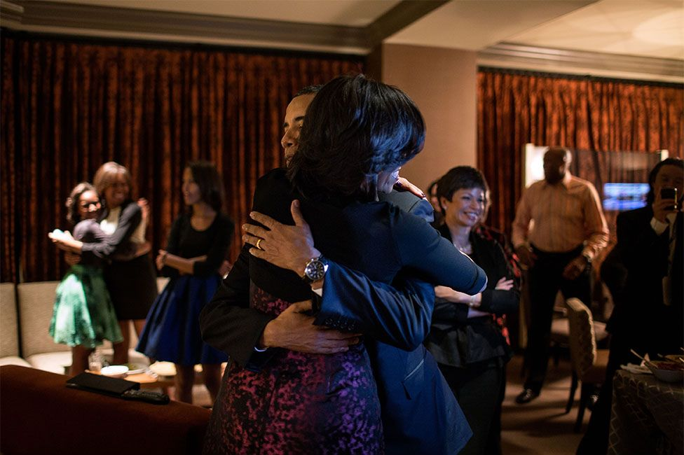 """November 6, 2012    Election Day    """"The Obama family and close friends were watching election results at a Chicago hotel. The President had warned everyone that it could be a very late night. Yet, only a few minutes later, the networks projected that he had been re-elected, and the President embraced the First Lady, while in the background, daughter Sasha hugged one of her cousins."""" (Official White House Photo by Pete Souza)"""