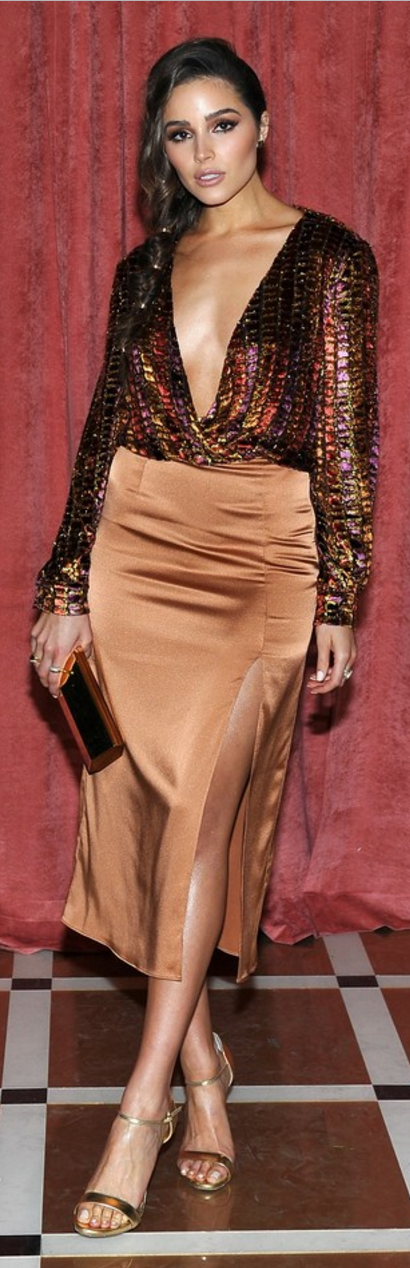 Who made Olivia Culpo's gold jewelry, sandals, satin skirt, and sequin top?