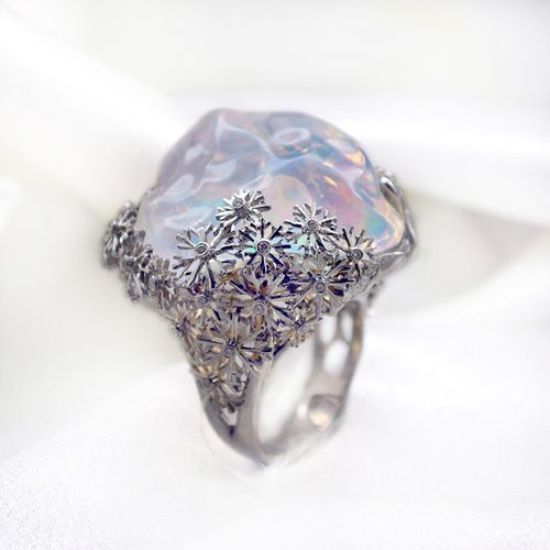 Ring. Stones Diamonds grit, Opal. Material Gold 750