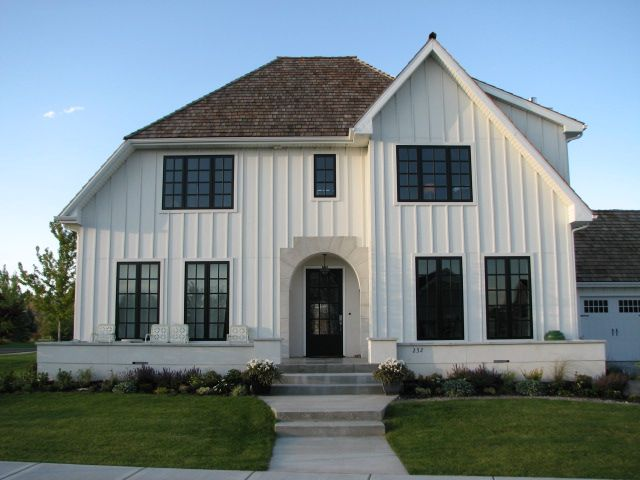 White house black window frames vertical siding for Farmhouse style siding