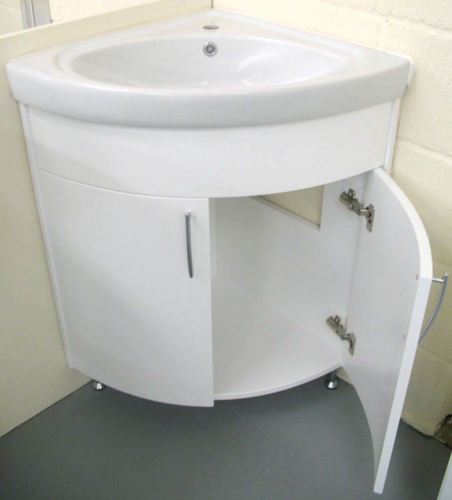 White Corner Bathroom Cabinet With Sink In Front Of Small Bathroom ...