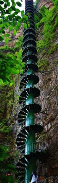 """Stairway to heaven: 300ft spiral staircase to give tourists a taste of the high life • """"The 300ft spiral staircase has been installed on the wall of the Taihang Mountains in Linzhou, [Henan, China] to offer the thrill of mountaineering without the danger."""" • by Sara Malm • photo: CEN"""