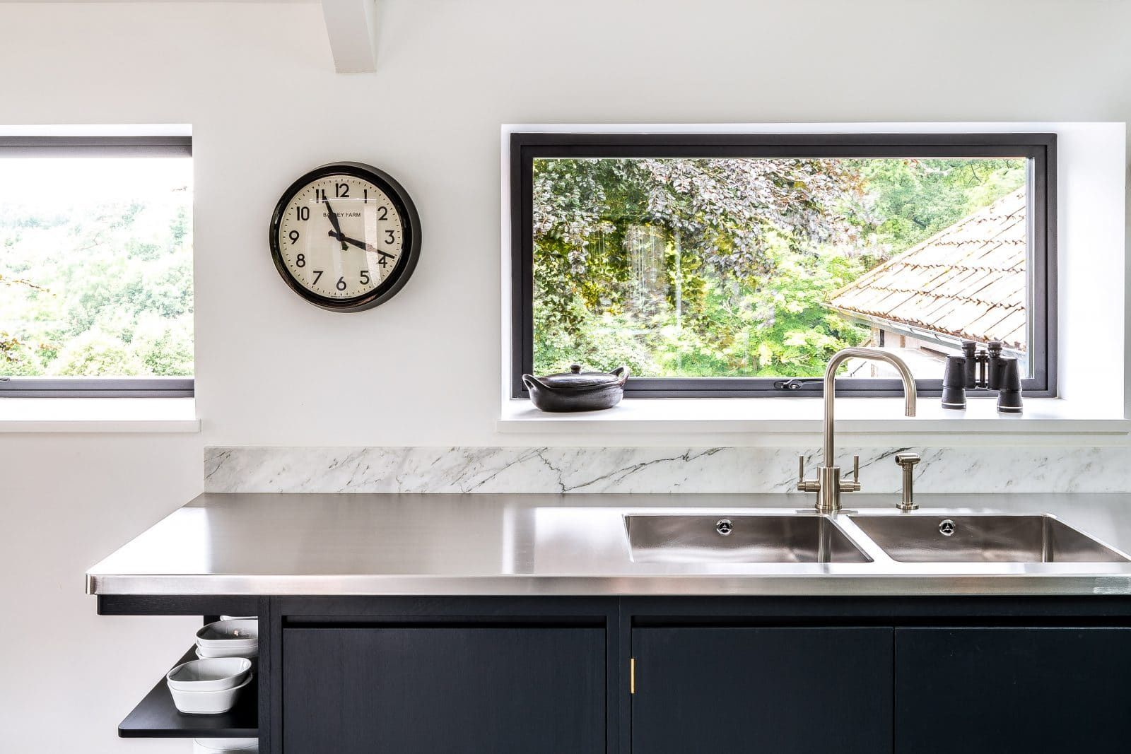 Steel and Marble Kitchen with Reclaimed Wood Feature