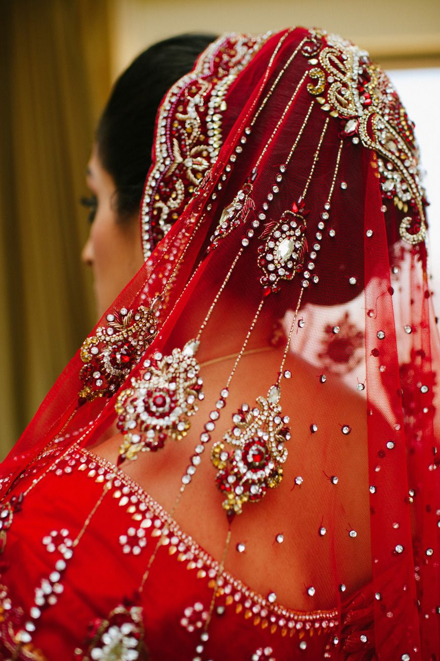 indian bride wearing red lehenga and bridal hairstyle