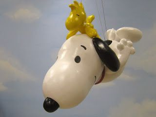 Snoopy and Woodstock in the 2013 Macy's Thanksgiving Day Parade.  The beloved beagle has appeared in 32 parades, and this is the 7th version of a Snoopy balloon. #MacysParade @nyccheap www.nyconthecheap.com