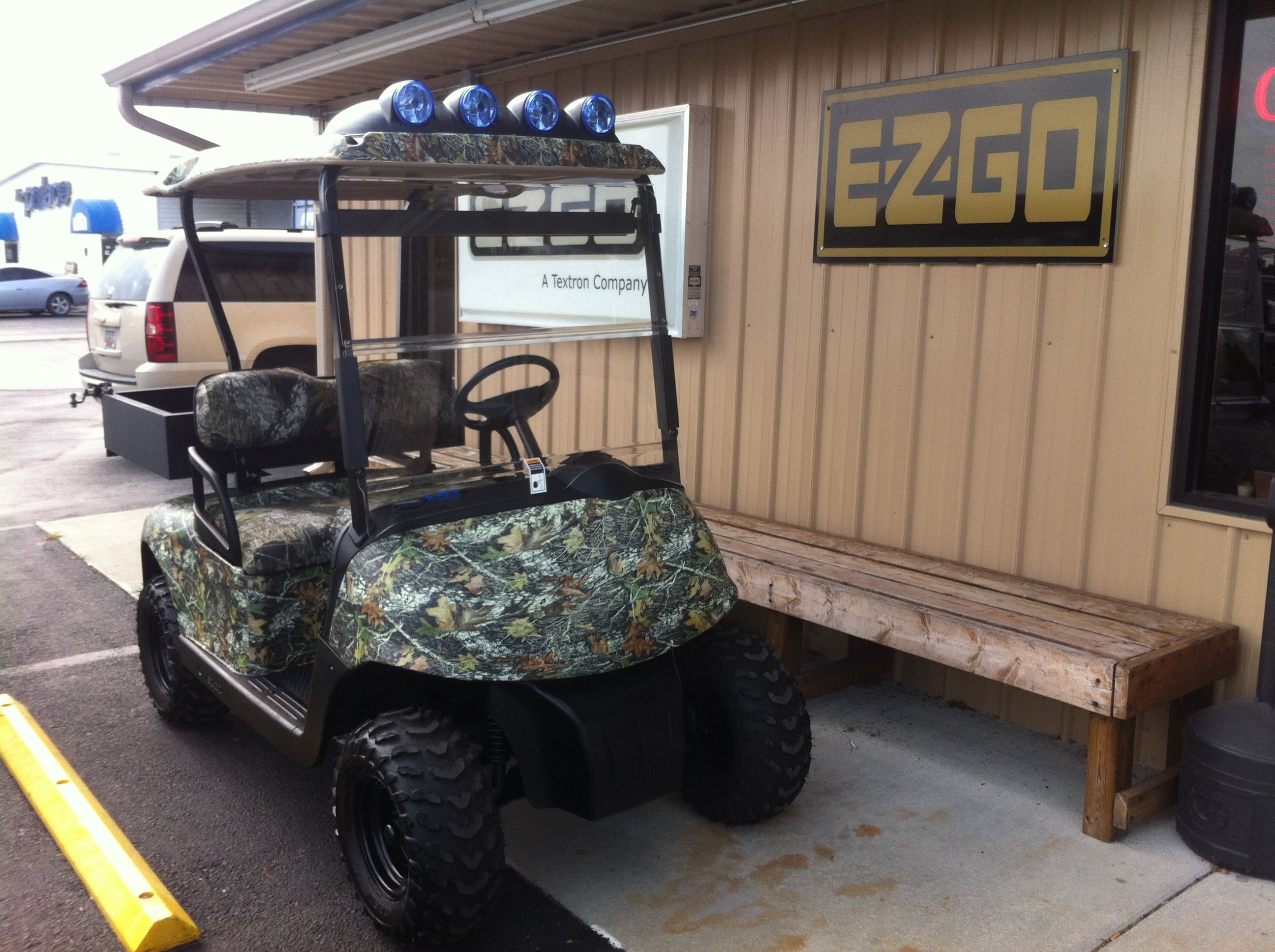 Custom Camo dipped golf cart body and top with custom camo