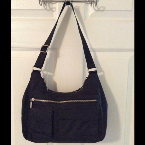 Banana Republic Black Nylon Shoulder Bag Silver hardware.  Nylon bag.  Front zip pocket and 2 front Velcro pockets.  Main zip closure.  Adjustable strap.  Interior zip pocket.  Measures: 11x3x7x12. Banana Republic Bags Shoulder Bags