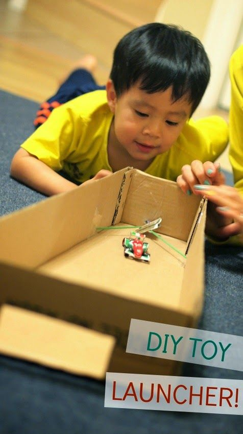 DIY Toy Launcher!  Fun and easy STEM activity- build a launcher to launch cars, planes, pom poms, and balls from cardboard and rubber bands!