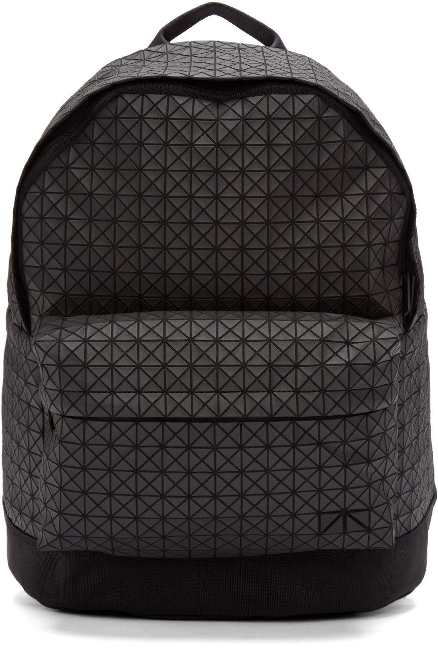 Lightly structured canvas backpack in black. Raised matte coating  throughout featuring geometric pattern. Grosgrain carry handle at top. e0c38d00e50ee