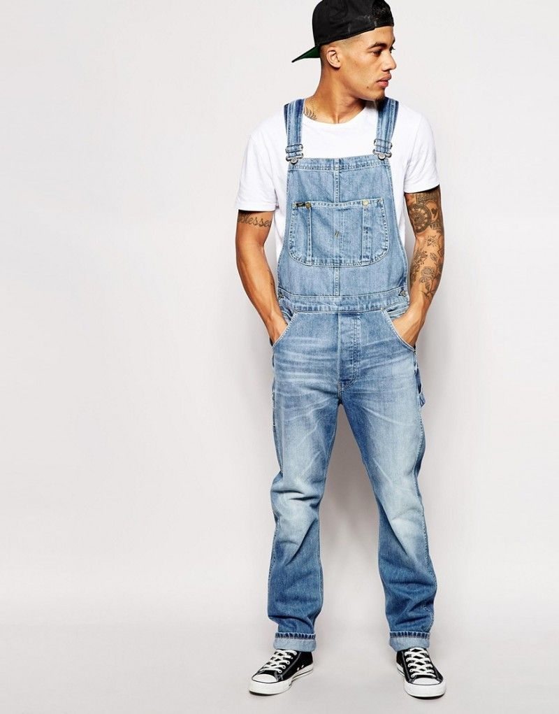Having stepped out of the farmer's shadow, bib overalls appear in a variety of colors, fabrics and styles for men's casual wear. Pair them with a tee, a crisp button-front shirt, or a turtleneck sweater and wear them any season.