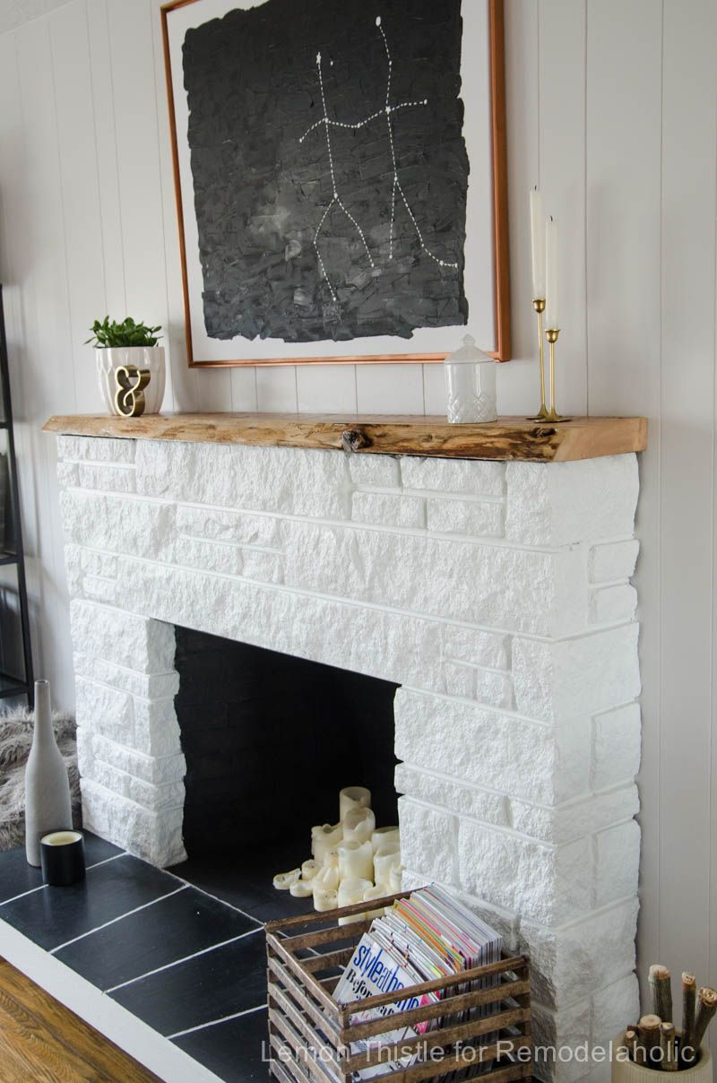 A stone fireplace painted to update and a beautiful liveedge wood