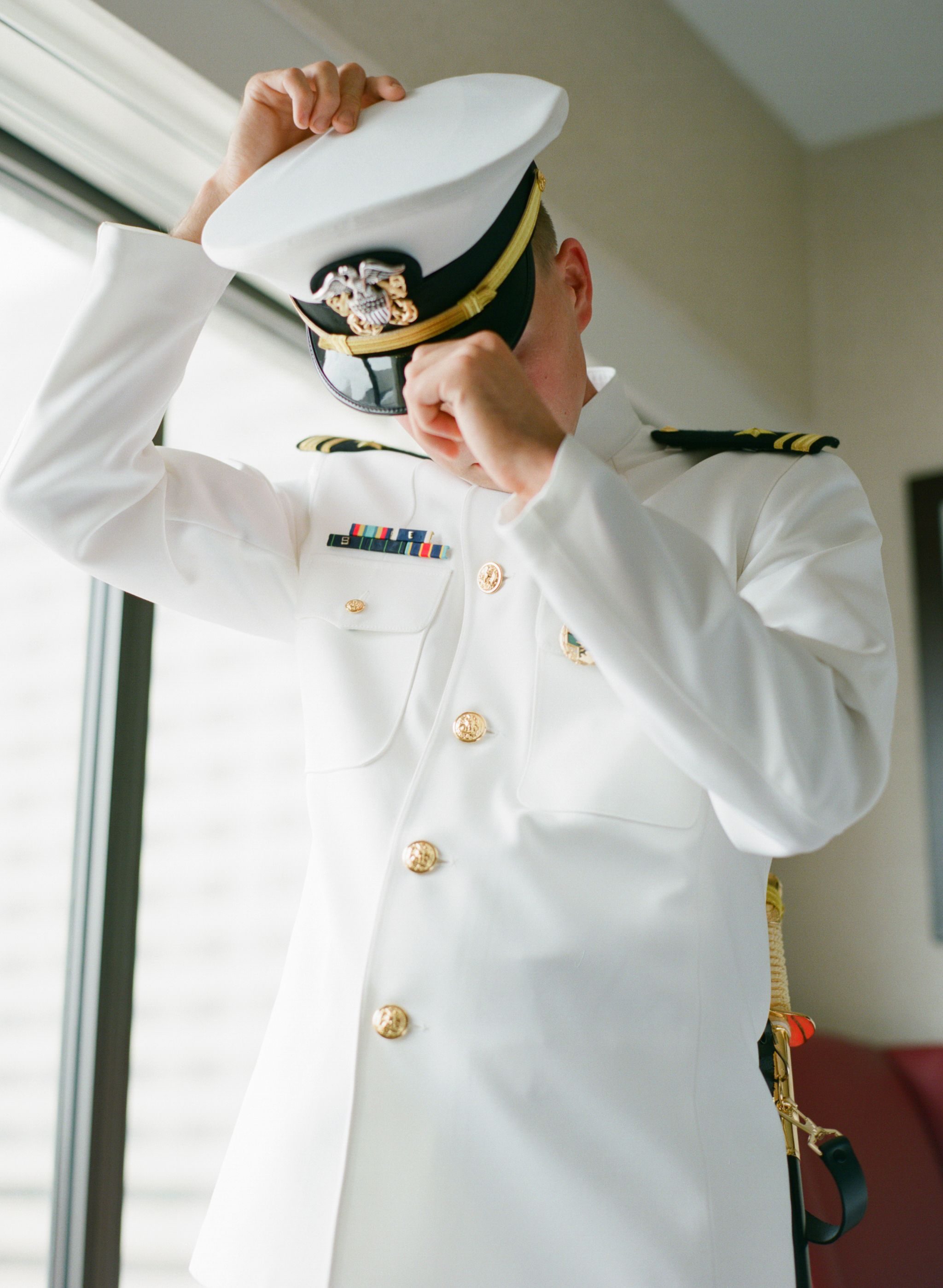 My groom getting ready in his US Navy dress whites for our ...