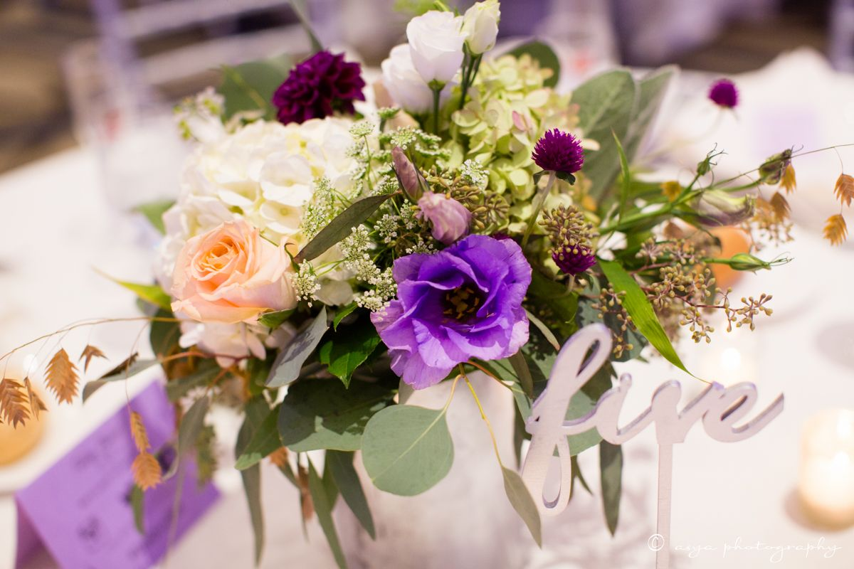 Purple centerpiece ideas purple lisianthus plum dahlias peach