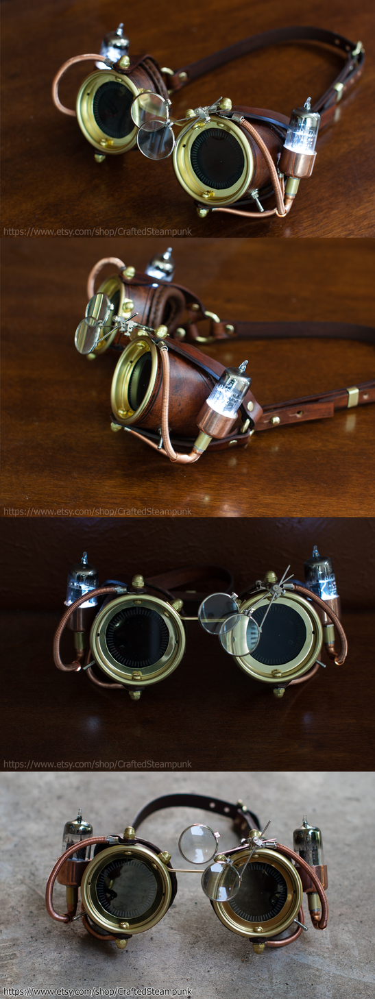 Ornate Steampunk Wrist Cuffs with mechanical pocketwatch, mini Telescope, tooled leatherworks, special antique copper Patina finish , fine nappa leather on the backside. Available here: www.e..