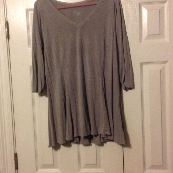 Lane Bryant Light gray top Soft and comfy with great style.  Hardly worn, but does have a small spot on pic and slight stitching pull. Lane Bryant Tops Tees - Short Sleeve