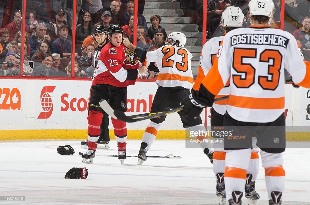 Chris Neil #25 of the Ottawa Senators fights with Brandon Manning #23 of the Philadelphia Flyers at Canadian Tire Centre on November 21, 2015 in Ottawa, Ontario, Canada.